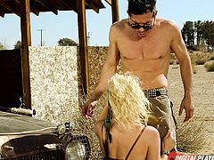 In this post apocalyptic wasteland mad max is tearing up the dessert on wheels. He stops by an abandoned barn and pulls out his cock so his blonde bitch can suck him off. They head inside to fuck like crazy.