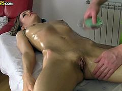 Slim and oiled, Sabrina looks smoking hot all laid on that table and waiting for a pair of firm hands on her body. The masseur rubs her gently in the beginning and then goes rough between her thighs. He slides a finger in her pussy and makes Sabrina moan and drool for cock. Seems that she will get some!
