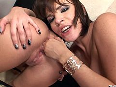 Press play to watch these wild cougars, with shaved love tunnels wearing thongs, while they touch and lick each other hard until they cum.
