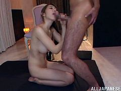 Horny Japanese dame with long hair in miniskirt pose lovely before giving her masked horny guy a superb blowjob in a cozy room