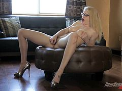 Watch the horny blonde Allie James masturbating with a dildo before her pink pussy is drilled by a big black cock as she moans like never before.