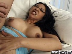 Sizzling Asian chick Mika Tan kneels in front of a man and sucks his wang. After that the guy drives his weiner in Mika's tight brown cave and fucks it in the reverse cowgirl pose and doggy style.