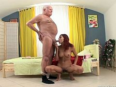 Dirty red haired harlot blows smelly penis of grey haired kinky stud