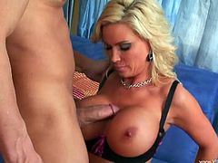 Hot cougar with fake tits in black thong gives her guy a blowjob before getting her juicy pussy nailed hardcore til the he cums in her mouth