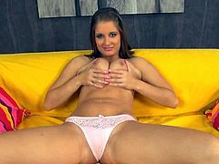 Claudia Come is ready for some amazing solo action on her yellow couch. She wastes no time and shows her big natural tits before rubbing her tight bald pussy.