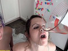 Make sure you check out this hot scene where these kinky ladies drink one another's piss after peeing in a measuring cup.