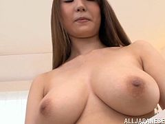 Curvy Japanese dame with long hair in miniskirt unpins her attire lovely before showcasing her natural tits in cozy room