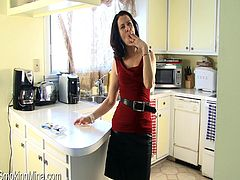 This horny, sexy MILF pulls out her natural tits while standing in the middle of her kitchen showing off her smoking fetish.
