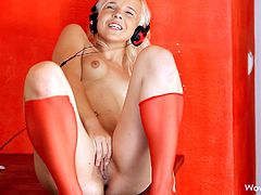 Monroe is a special whore. This amazing blonde got her headphones on and listens her favorite music. She takes her panties off on the music rhythm and begins to rub her bald cunt. The music changes and her movements are more sensual. She takes off her headphones and rubs her wet cunt, while moaning like a crazy bitch.