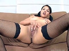 Jovial brunette with shaved pussy in black fishnets displays her sexual organs before sucking balls and getting nailed doggystyle