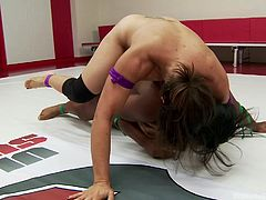 Jayogen is in the wrestling arena with her opponent, Loven. She gives her best to dominate that black ass and finally, manages to show her who's boss. After a hard and dirty mach Jayogen takes out her strapon and makes the submissive whore suck on it. Will she pound her big black butt too?