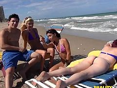 Imagine going to the beach, would you take someone home with you and offer money to get laid? That´s exactly what this video is about. Two bitches and a guy get loose in their hotel room. The horny babes get undressed and the blonde slut begins sucking cock. Ready for some action? Click to see!