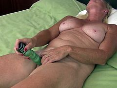 This dirty blonde mature has wrinkly, dry skin and a pair of natural tits. She lays back on her bed and sticks her vibrator in her old cunt. She moans as fills herself with her sex toy. Watch her reaching orgasm.