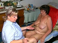Salacious mature bitch Gisela is having lesbian fun with her neighbour. The women get naughty in the bathroom, then go to a bedroom and play with dildos there.