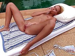 Blonde woman Nataly Von finds herself horny and takes dildo in her muff with passion