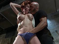 Derrick got his hands on this amazing milf called Veronica. She has amazing large breasts and very sexy lips. He takes her from behind and starts rubbing her cunt very hard while touching her boobs. His dick is on fire so she gets on her knees and gives him one deep rough blowjob.