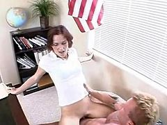 Red head chickreceives bent over her teaChers desk and has stretched
