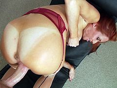 Beautiful redhead cougar with fake tits in panties masturbates passionately while showcasing her hot ass before getting fucked hardcore