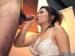 Are you a fan of Asian beauties? A lady wearing a white sexy bra is standing down on her knees performing an oral sex to a hairy guy. One will definitely remark how great are her blowjob skills. The bitch seems also friendly and concentrates on licking, sucking and swallowing right down the balls. Enjoy!