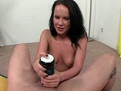 Katie St Ives uses a toy to pleasure his cock