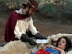 The explorers find Snow White in the middle of a field in a coffin, and they see an opportunity to have dirty sex with her. They wake her up and make her suck on those stiff cocks. They hold her by her wrists.