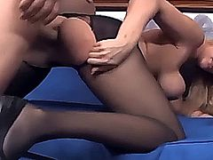 Pretty blonde with big tits having sex in ripped up crotchless nylons