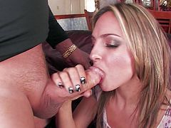 This dirty and slutty whore is down on her knees sucking on her man's massive pecker. She manages to get the whole thing down into her throat. They get into the 69 position, and she sucks him some more while he eats out her wet and juicy vagina.