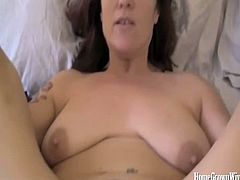 Slutty Annabelle Flowers chilling out lying on her bed smoking cigarette while she is fast jerking a dick making it stiff. She then rode her hairy pussy on it making her cum a lot.