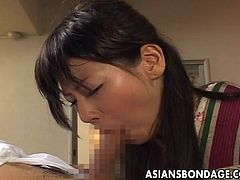 Are you aware that available Asian sluts have a big sexual appetite and love to please their partners in many kinky ways? The black-haired lady is wearing a kimono and is bound strongly. Sitting comfortable in an armchair, the horny guy asks for a blowjob. The helpless lady obeys his order and begins sucking.