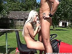 Superb blonde teenage nympho sucking and fucking an old dude's cock outdoors on a tractor