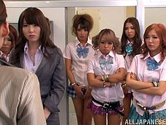 This scene features a group of Asian college students with their professors. Instead of having a class, it ended up with a group sex session.