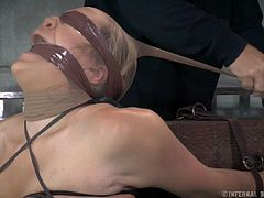 There are sadistic inventions created to offer pain and pleasure. Check out this blonde blindfolded slut trying an extreme bondage device. The merciless executor has terribly mouth gagged her, too. Eager to see Winnie's tits tortured aggressively? Stay and watch!
