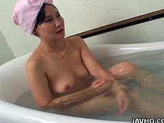 Don't you like Asian babes that act naturally when boys are around? This playful slut was caught while taking a relaxing bath. Instead of throwing out the guy, she lets him in and moreover, asks him to undress. See the attractive bitch seducing the intruder! Enjoy!