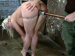 A blonde babe has to obey her merciless executor's every single kinky fantasy. The captive slut has been strongly tied up with inescapable rope bondage. She has big tits and is wearing a ball gag. Click to see her fingered and punished with a dildo.