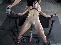 Bella is a pro and even she is at her limits this time. The bondage whore is almost at her breaking point as her executor stretched her limits, and her pussy. He bent her backwards, tied her hard and squeezed her oiled breasts, filled her pussy with a dildo and her throat with his dick. How long can she endure it?