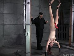 This slave needs to be punished by her cruel master. the naughty girl is tied up and hanged upside down so that the master has easy access to her vagina. He tears off her clothes and shoves a red stud in her cunt.