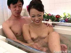 Alluring asian hot ass milf gives cock a blowjob in the tub