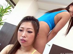 Beautiful Asian lesbian with hot ass in panties finishes doing some exercise before getting her pussy worked on using huge vibrator