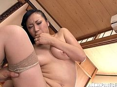This is a Japanese bang and hot blowjob scene with an Asian slut in stockings getting hairy pussy banged hardcore doggystyle.
