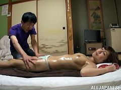 This sexy girl lays on her stomach so her man can give her a massage and rub oil all over her sexy body. He grabs her ass, and then he tells her to flip over so that he can grab her perfect round breasts. She enjoys the oily massage so much.