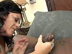 This dirty gilf has an addiction to big black cock. She comes into the bedroom and surprises her younger lover. Watch as she puts her lips on her massive black pecker and lick his giant balls. He guides her throat down onto his massive cock.