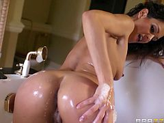 This is a hot and wild fuck scene with a shaved pussy fucking a hot stud's big cock hardcore doggystyle in the bath room.
