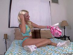 Naughty blonde chick Jessie Volt takes off her tight shorts and spreads her buttocks to show her pink asshole. She plays with her puffy pussy on the bed and then makes pink toy disappear in her asshole.