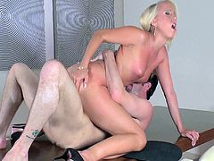 Blonde porn star with a hot body enjoying a hardcore anal fuck on a table