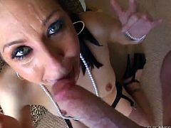 Captivating brunette cowgirl with long hair giving a steamy blowjob then as she fingers her pussy then strokes his cock till getting a facial cumshot