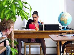 The atmosphere in the classroom changes, as the hot teacher remains alone with a horny student, who takes advantage from this occassion, to fulfill his lusty fantasies. The sight of the milf's big amazing tits is really exciting. Watch her laying on the desk with legs widely spread, hardly waiting to be banged!