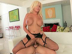 Charming blonde porn star with big tits and long hair in fishnet stockings giving a dishy hand job before getting hammered hardcore