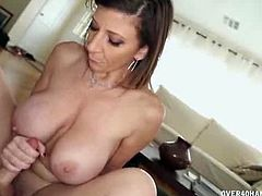 Sara Jay is a really busty milf with mad cock-stroking skills and teasing skills as well. She reveals her set of boobs and she begins to massage Jeremy's cock.