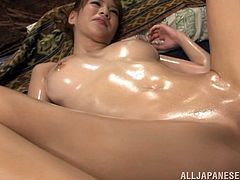 Slender Japanese Milf with Natural Tits touches a hard rod then she is Oiled all over given hot Tit job before pounded Doggystyle