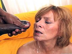 This granny is in the ghetto to suck on big black dick. She has two men to get off and they beat off in front of her, to spread thick white cum all over her lips and face. She even gets some in her eyes. In the next scene, another redhead sucks the cocks of three different men.
